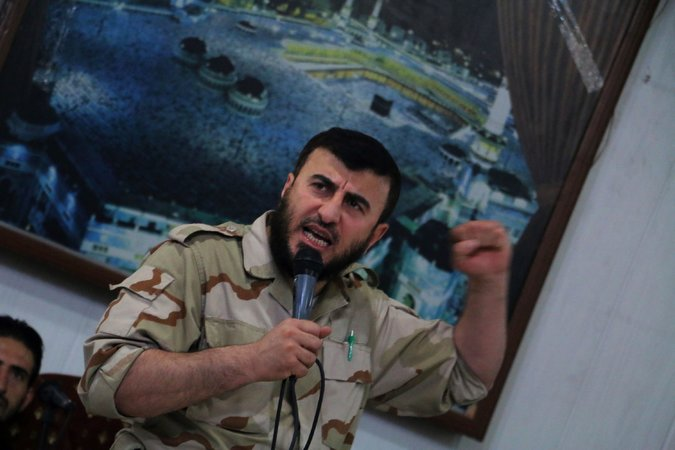 Zahran Alloush, who spoke at a wedding in July, led the Army of Islam insurgents in Syria. The group recently agreed to participate in a political process seeking to end the five-year-old conflict. Credit: The New York Times/ Amer Almohibany/Agence France-Presse — Getty Images