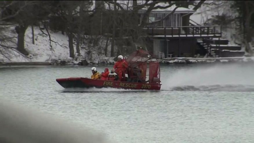 A search crew looks for two missing men on Lake Beulah, in East Troy, Wis. The bodies of two other men were pulled from the lake Sunday. Photo: Fox News/WITI