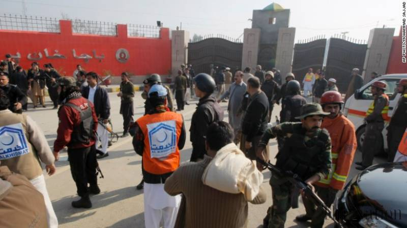 Security officials gathered outside the university. Photo: The Nation Pakistan/AP