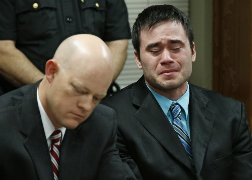 Daniel Holtzclaw, right, cries as the verdicts are read in his trial in Oklahoma City. At left is defense attorney Robert Gray. A jury found former Oklahoma City police officer Holtzclaw guilty of raping and sexually victimizing eight women on his police beat. Credit: The Boston Herald/AP Photo/Sue Ogrocki, Pool, File
