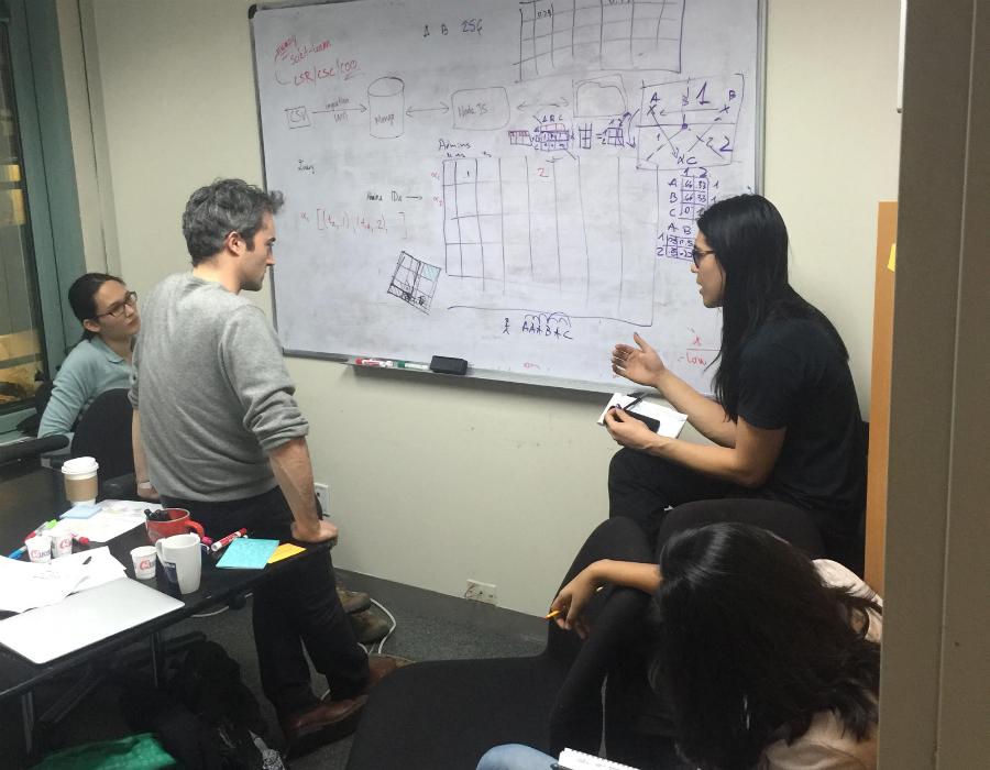 Google software engineers John Li and Zora Tung with UNICEF research scientist Manuel Garcia Herranz and UX designer Tanya Bhandari working on the open source data platform. Photo: Google Blog