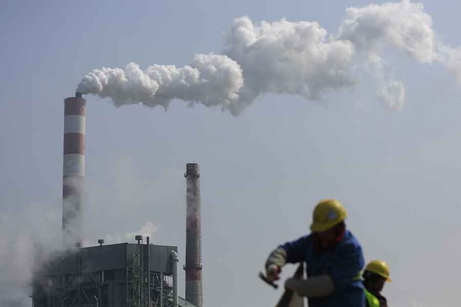 China's carbon dioxide emissions appeared to go downhill since the 2014 emission's peak, said the report published Monday. Photo credit: Reuters