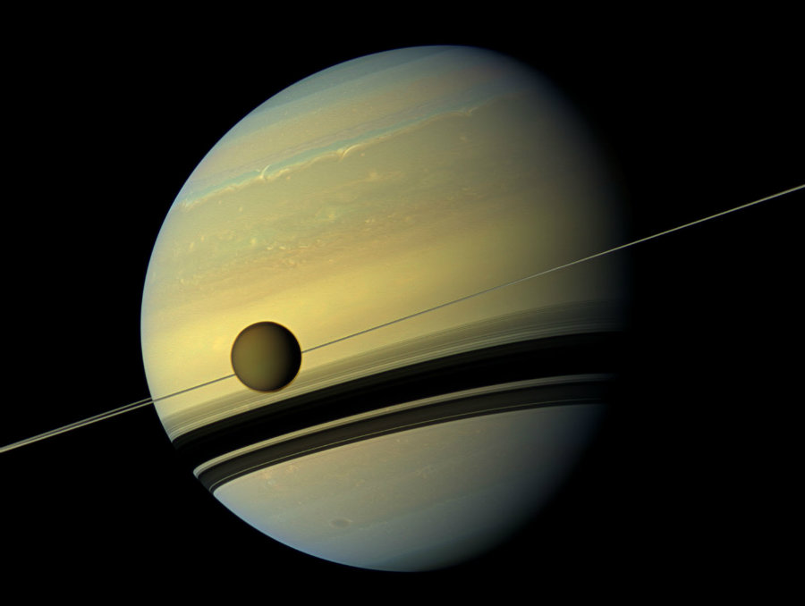 NASA has identified the highest point on Titan, the largest moon of Saturn, which measures 10,948 feet at its highest peak. Photo credit: Daily Galaxy