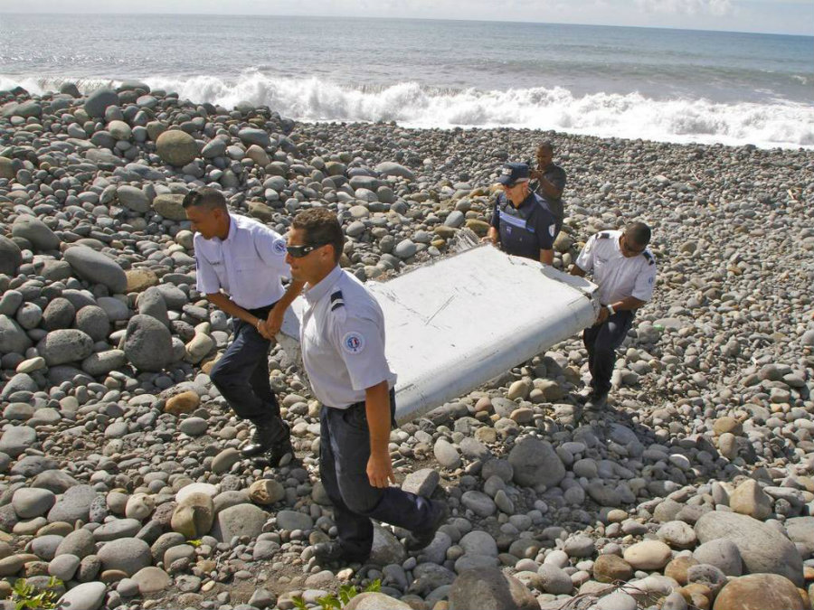 Tourists found remains of an airplane while on vacation that could be part of the missing flight MH370. Photo credit: News Crown