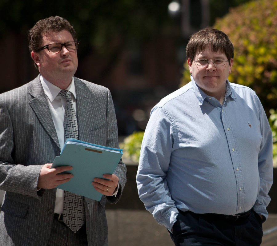 Matthew Keys convicted to two years in prison after being found guilty on three counts violating the Computer Fraud and Abuse Act walking alongside one of his attorneys. Credit: Engadget