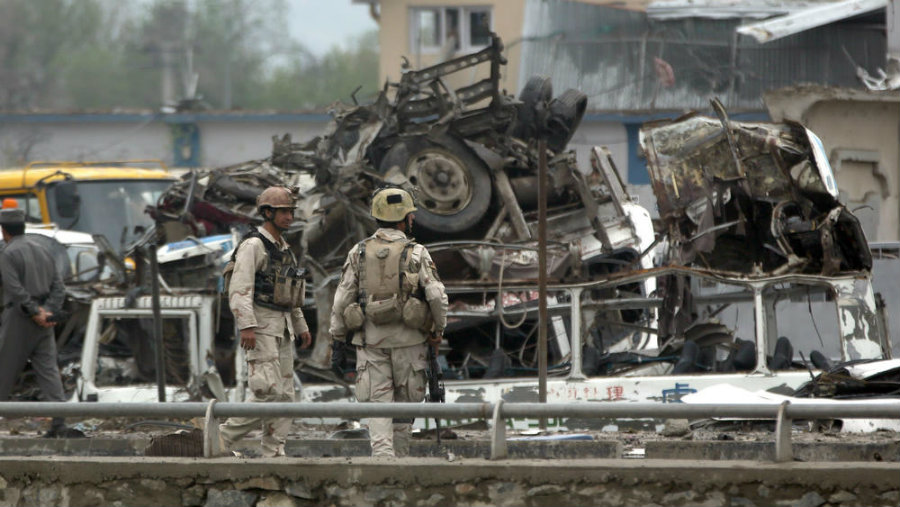 A suicide bomber arrived in a vehicle full of explosives to the parking lot of the training ground for Afghan Intelligence unit. Photo credit: Massoud Hossaini / Associated Press / LA Times