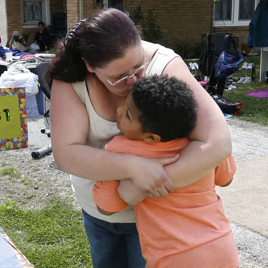 Tristan Jacobson with his soon-to-be adoptive mother Donnie Davies on Friday at his lemonade stand on Friday. Credit: News Leader