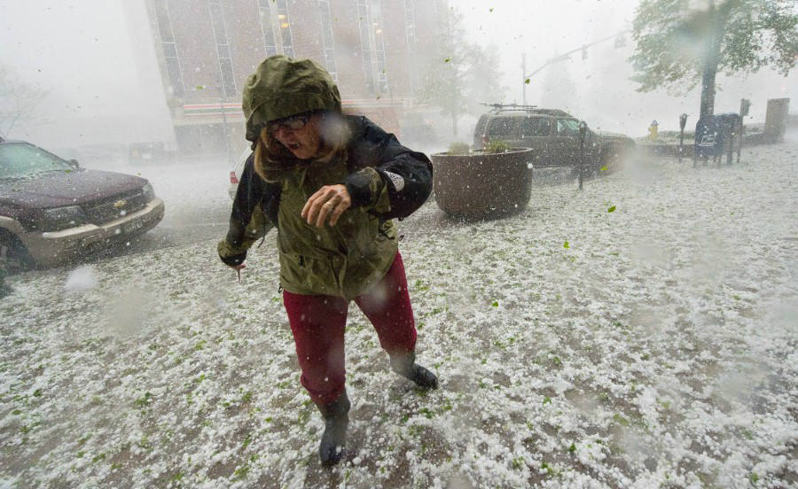A photo of a pedestrian running to shelter on Wednesday. Thunderstorms filled the sky of Oklahoma City, which ended up in a large scale power outage. Credit: CNN