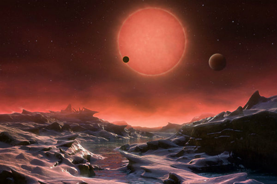 An international team of astronomers has discovered three Earth-like exoplanets orbiting the dwarf star now known as TRAPPIST-1. Photo credit: ESO / M. Kornmesser / AP