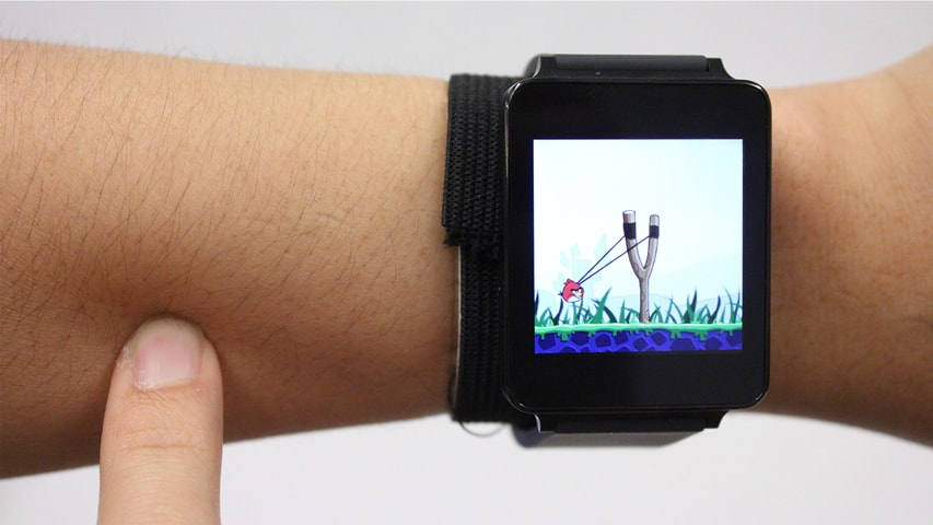 As seen above, a demonstration on how Skin Track would allow people to get out from the smart watches' screen without losing the touch-interface. Image Credit: CMU