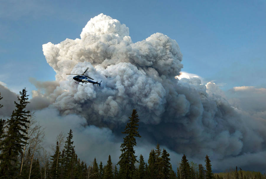 Authorities have yet to determine what sparked the inferno in Canada's oil sands region on April 30. Image Credit: New Yorker