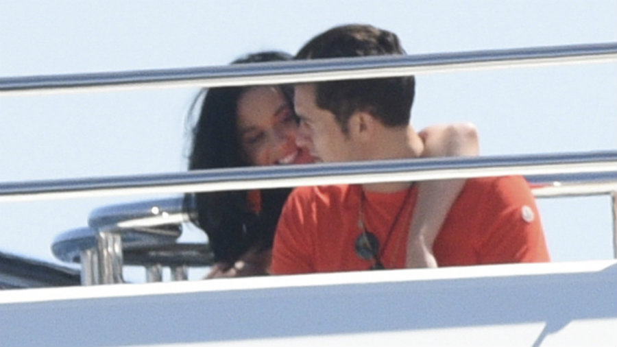 The star duo was spotted traveling on a yacht while kissing, hugging and laughing. Photo credit: AKM-GSI