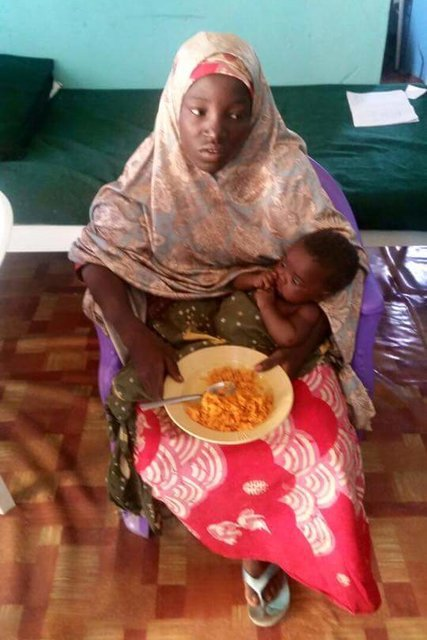 The girl found Tuesday, identified as Amina Ali, was carrying a baby and was with a man who apparently was her husband and the father of the child. Photo credit: Nigerian Military / The New York Times