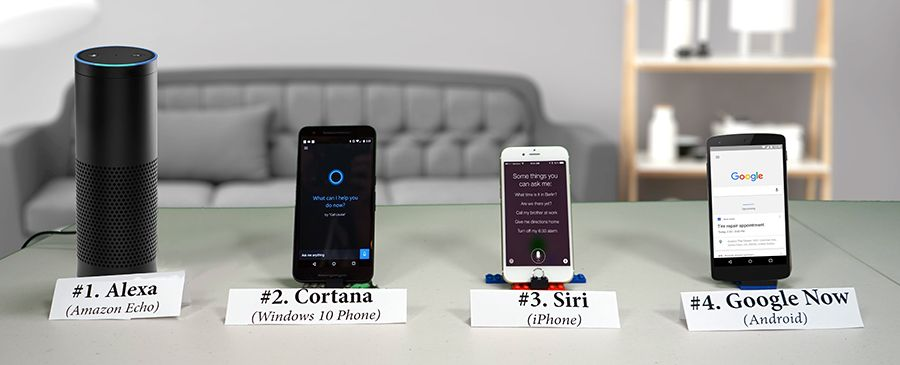 Each device put side by side, from left to right, there's the Alexa Amazon Echo, followed by Windows' 10 Phone Cortana. Next on there's Apple's Siri on the iPhone and Google Now powered by Android. Image Credit: Yahoo