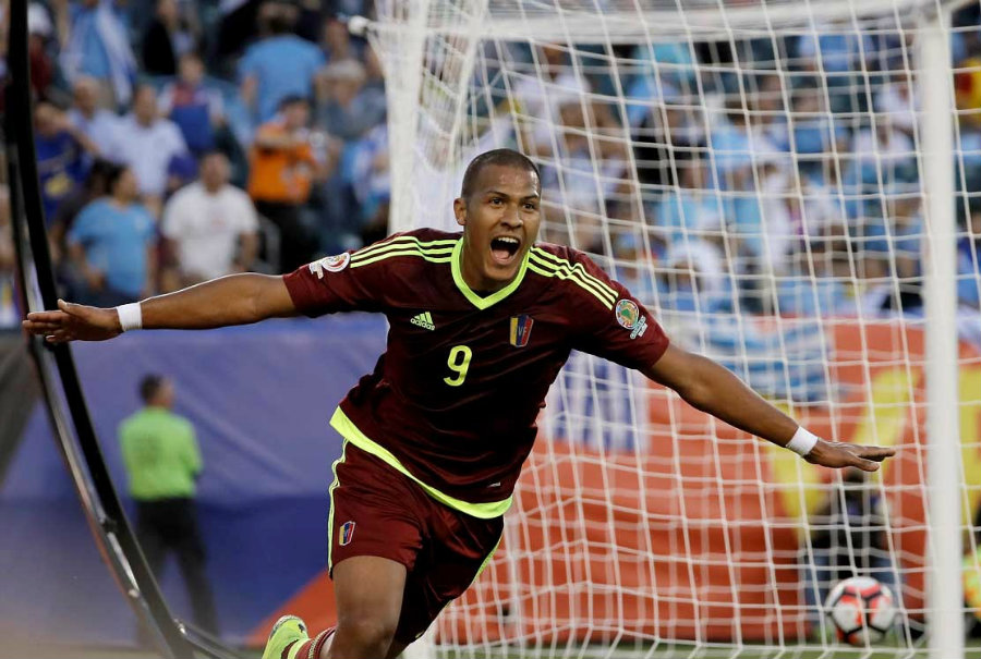 Venezuelan people have something to celebrate as their soccer team, La Vinotinto, managed to defeat Uruguay for the first time at a Copa América. Photo credit: AP / Panorama