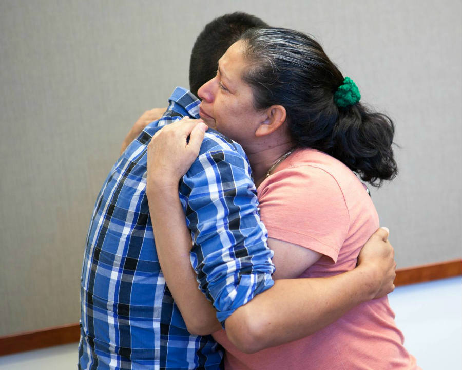 A woman from California hugs her son for the first time in 21 years. The woman's son was abducted over two decades ago. Image Credit: Fox32