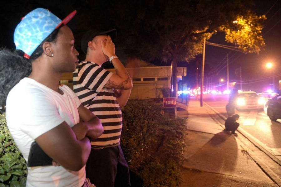 After law enforcement officers arrived at the scene in Florida's Pulse nightclub, two witnesses wait anxiously for the stand-off to be over.