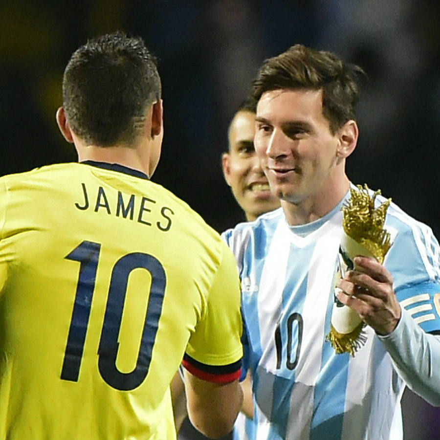 Both the captain for Colombia's team James Rodriguez and Argentina's captain Lionel Messi meet center field before the game. Amazingly, both wear the number 10 and play almost the same position, accordingly. Image Credit: GOAL