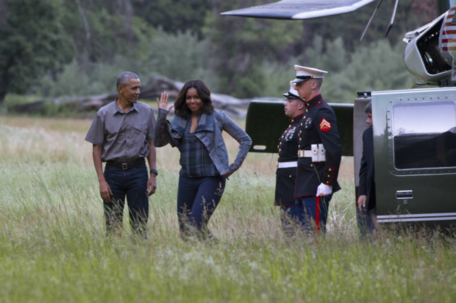 The First Lady Michelle Obama waves to the cameras while getting ready for the Obama family's trip to Yosemite. Image Credit: Daily Mail