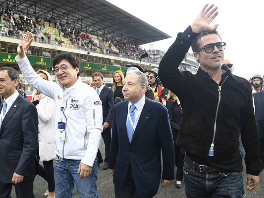 Both Jackie Chan and Brad Pitt shared a laught or two at today's Le Mans 24 hour race. Image Credit: The Celebrity Auction