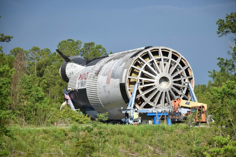 A massive 40-year-old rocket booster that never made it to the moon arrived Tuesday to Mississippi's Infinity Science Center for a new mission as a roadside attraction. Photo credit: INFINITY Space Center / Gizmodo