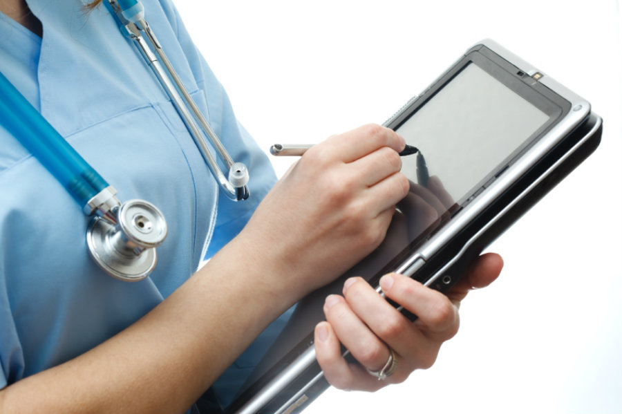 Doctors who use electronic health records (EHR) - an electronic version of a patient's medical history - tend to have a higher risk of burnout. Photo credit: Center for Health Journalism