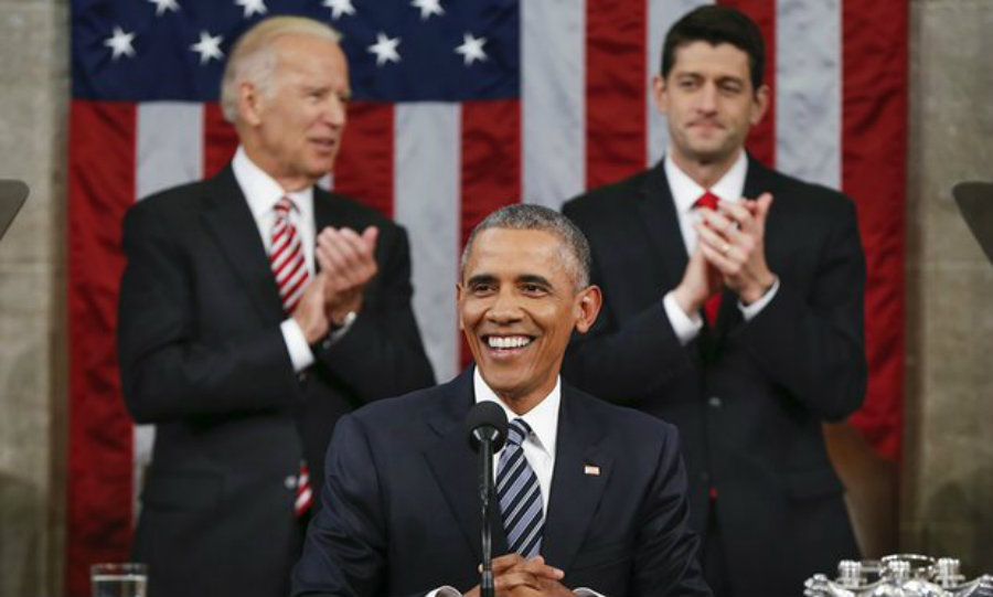 President Barack Obama smiles to a camera during a public statement. Joe Bidden claps at the end of the meeting alongside Paul Ryan. Image Credit> The Guardian
