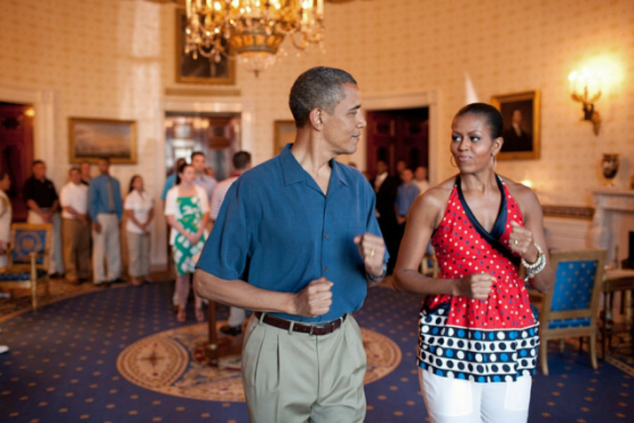 President Obama and First Lady Michelle Obama walk to the beat of a song as practice for later on the President's last 4 of July barbecue at the White House. Image Credit: White House