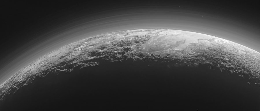 The dwarf planet Pluto offers a particular sight to behold as its mountains go from foggy hazes to frozen plains. Image Credit: NASA