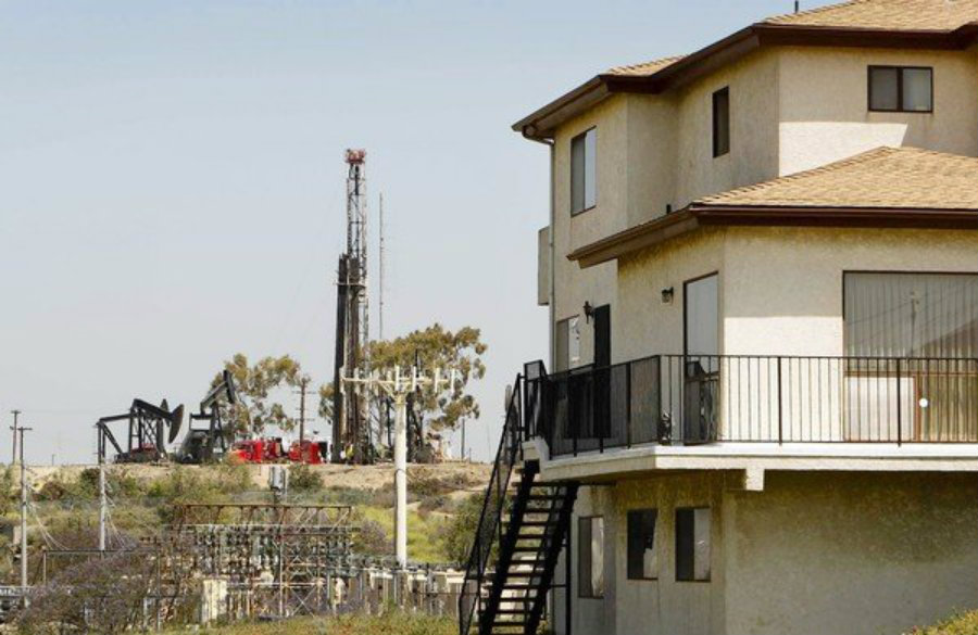 For people living next to a fracking well, there's plenty of downsides when it comes to living in a healthy environment. Image Credit: LA Water Keeper