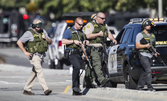 San Bernardino police officers in SWAT gear securing the place after the shooting. Photo: Gina Ferazzi/Los Angeles Times/Getty Images