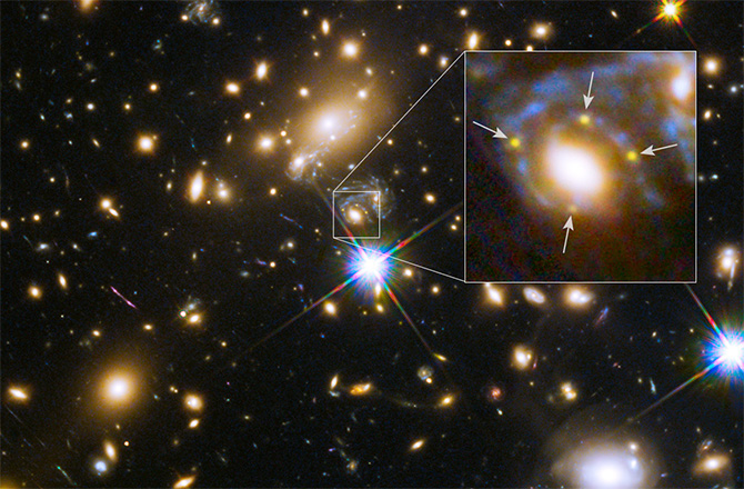 Occasionally multiple images of the same object can be seen around gravitational lenses. In this spectacular example, an ancient supernova in a distant galaxy has been magnified by the masses of galaxies contained within the MACS J1149.6+2223 cluster, located 5 billion light-years away. Credit: Discovery.