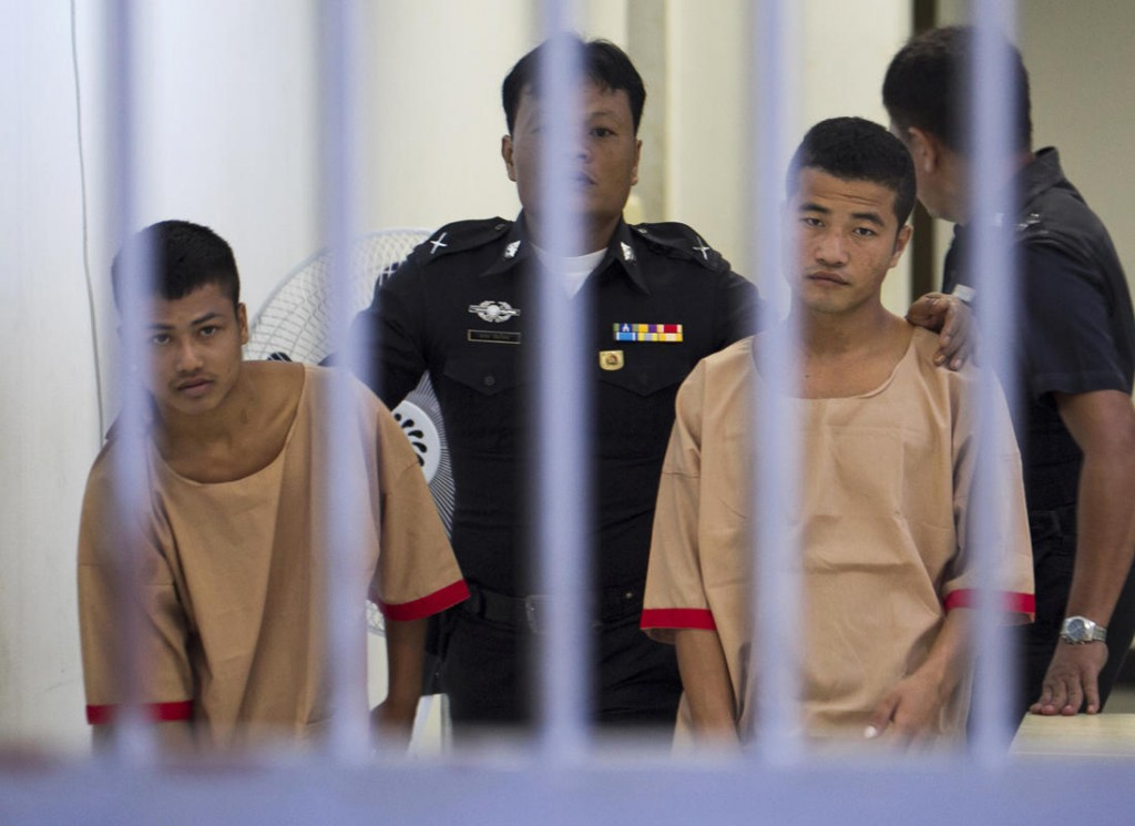 Myanmar migrants Win Zaw Htun, right, and Zaw Lin, left, both 22, are escorted by officials after their guilty verdict at court in Koh Samui, Thailand, Thursday, Dec. 24, 2015. Credit: The Boston Herald/AP Photo/Wason Wanichakorn