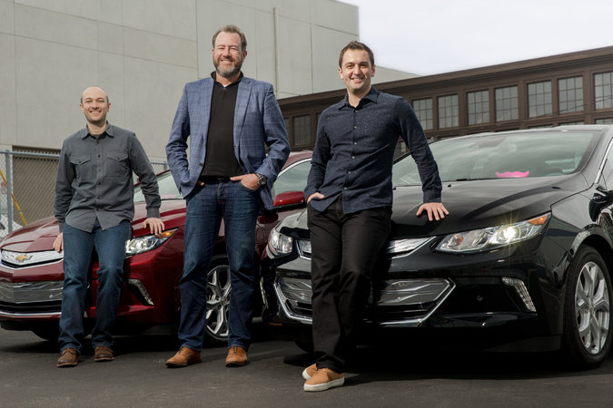 Logan Green, left, chief executive of; Daniel Ammann, president of General Motors; and John Zimmer, president of Lyft. Photo: Lyft.