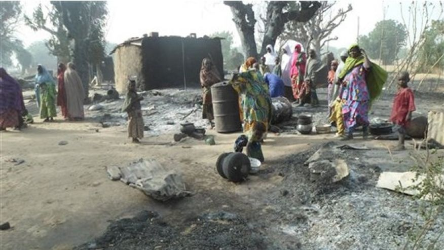 Women and children look at burnt out houses following an attack by Boko Haram in Dalori village 5 kilometers (3 miles) from Maiduguri, Nigeria, Sunday Jan. 31, 2016. Credit: Fox News/AP Photo/Jossy Ola