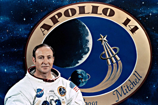 Apollo astronaut Edgar Mitchell poses in front of his mission patch in an undated picture released by NASA. Credit: The Christian Science Monitor/NASA/Reuters/File