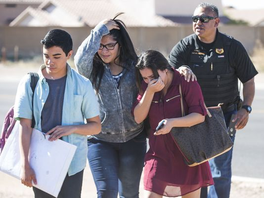 Crying students leaving the school after the campus was locked down. Photo: USA Today