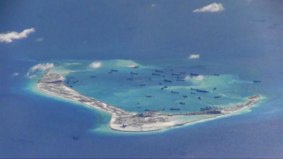 Chinese dredging vessels are purportedly seen in the waters around Mischief Reef in the disputed Spratly Islands in the South China Sea, May 21, 2015. Credit: Reuters