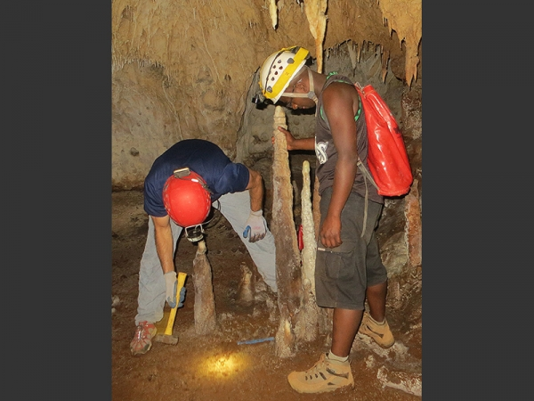 In the picture are Professor Stephen Burns from University of Massachusetts and Peterson Faina in Anjohibe Cave. Photo: Laurie Godfrey/MIT