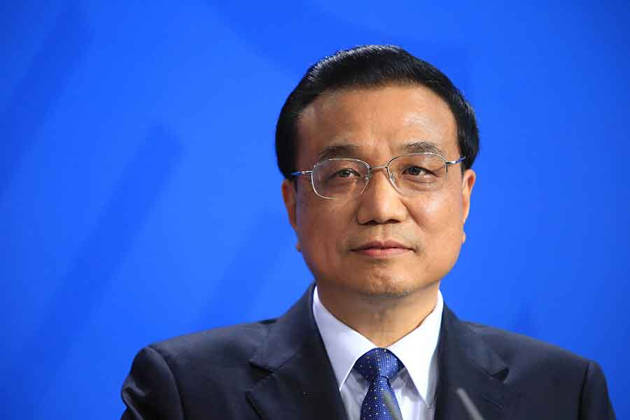 China is aiming for a 6.5 to 7 percent of economic growth in 2016 as it tries to keep consumer inflation around 3 percent, commented Premier Li Keqiang. Photo credit: Krisztian Bocsi / Bloomberg