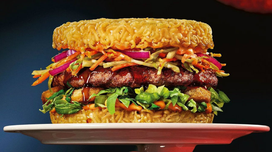 Ramen based burgers will now be available across the United States starting April 4th, for a short period of time. Photo credit: Red Robin / Eater