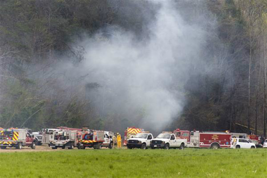 Emergency vehicles respond to the scene of a fatal helicopter crash on April 4, 2016, in Pigeon Forge, Tenn. Credit:  Saul Young / Knoxville News Sentinel via AP / NBC News