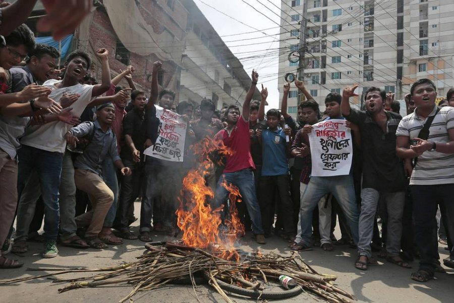 Students protested Thursday in Dhaka after Nazimuddin Samad, a law student and secular activist, was hacked and shot to death in the Bangladeshi capital the day before. Credit: Associated Press / The Wall Street Journal