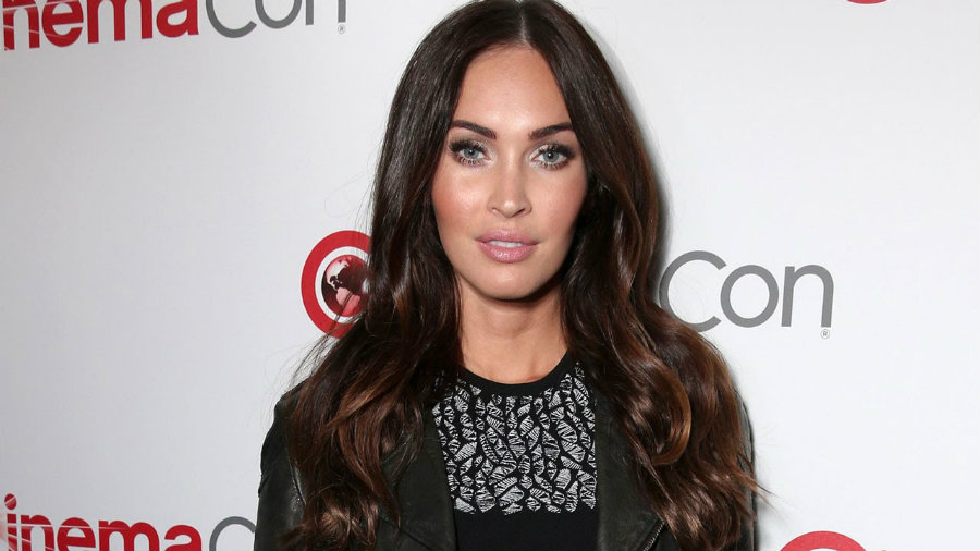 Megan Fox happily showed off her third pregnancy on Monday at CinemaCon in Las Vegas. Photo credit: Wonder Dream