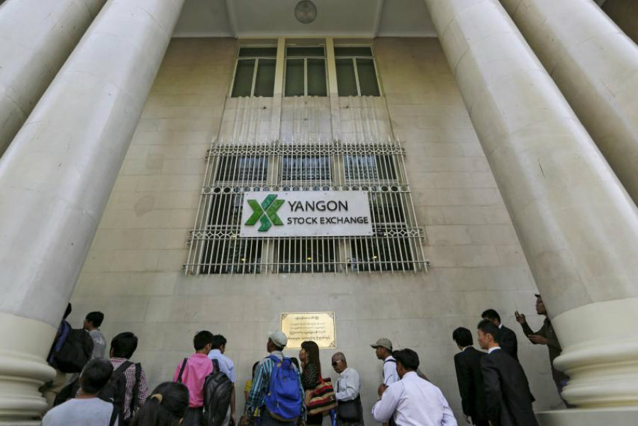 People wait at Yangon Stock Exchange in Myanmar, March 25. An earthquake struck western Myanmar on Wednesday, more than 200 miles north of Yangon. Credit: Soe Zeya Tun / Reuters / Newsweek