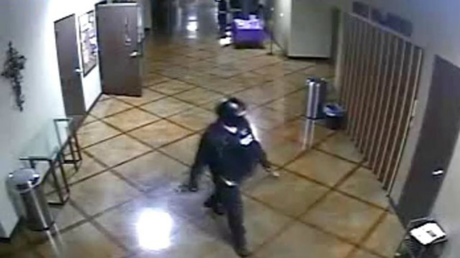 A motion-activated camera showed that before the fitness trainer arrived, an unidentified man was in the building walking around the church dressed up like a police officer on an SWAT-style raid. Photo credit: 30A TV News