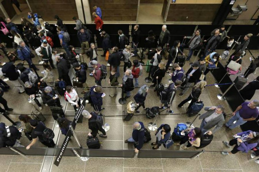 As seen above, passengers wait in line to go through the new north security checkpoint at Terminal 1 of Minneapolis-St. Paul International Airport. Image Credit: Wall Street Journal