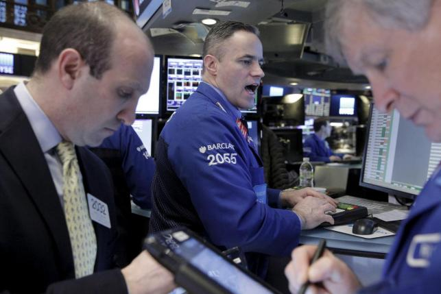 Traders work on the floor of the New York Stock Exchange (NYSE) February 12, 2016. Image Credit: Reuters