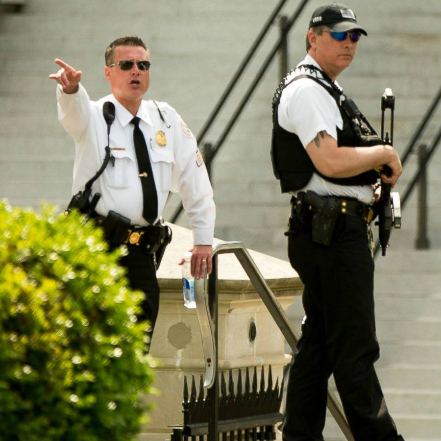 Law enforcement personnel stand south of the White House on Constitution Ave., in Washington. Image Credit: ABC News