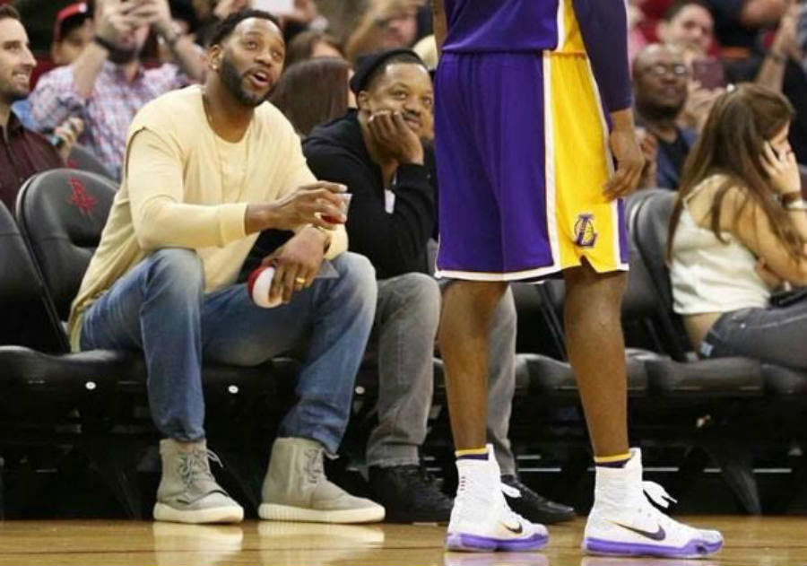 As seen above, T-Mac rocking the Yeezy 750s at a Laker's game last month